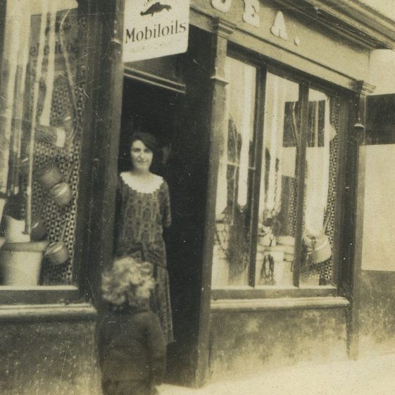 Mary O'Dea in front of her father's shop, Main Street Clarecastle 1925