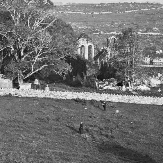 Killone Abbey with two people | Lawrence Collection - NLI