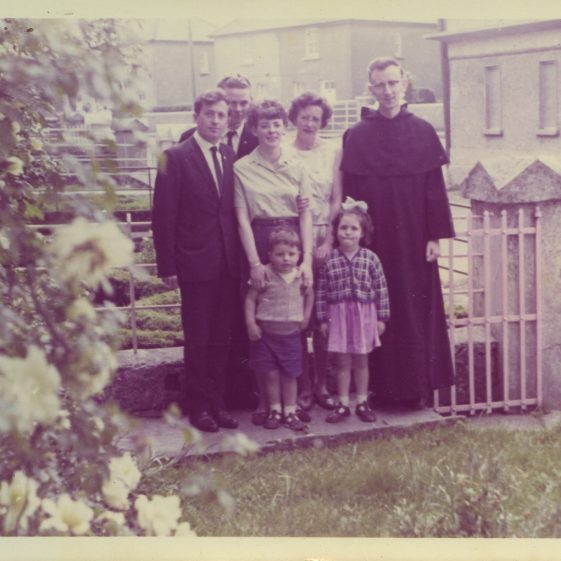 Eric Shaw, Pat Moloney, Anne Madigan, Mrs Madigan, Fr Noel Herlihy, Kierse children at 2, Quay Road, Clarecastle.