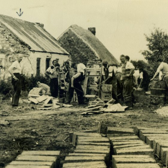 Abbey Hall under construction -making concrete blocks by hand. Note the houses in the Clare Commons in the background | Sergeant Long