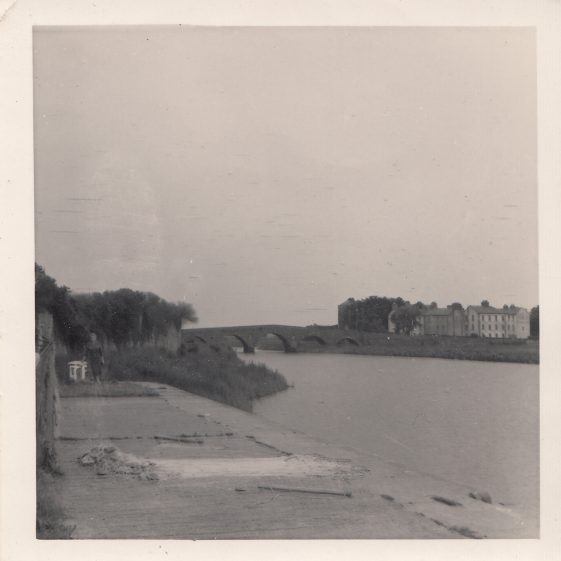 The Quay with Mrs Navin, and the Clare Bridge in the background | Pat Navin