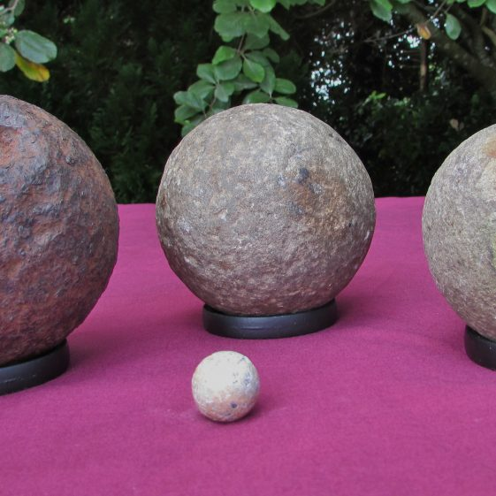 Cannon balls found in 1. Sheedy's Orchard by Frank Power . 2 Clare Castle by Noel Guinnane. Clare Abbey by Chris Crosby. Photo by Eric Shaw