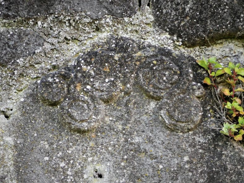 stone with carved design. This may have come from an earlier building on the site | Christy Leyden