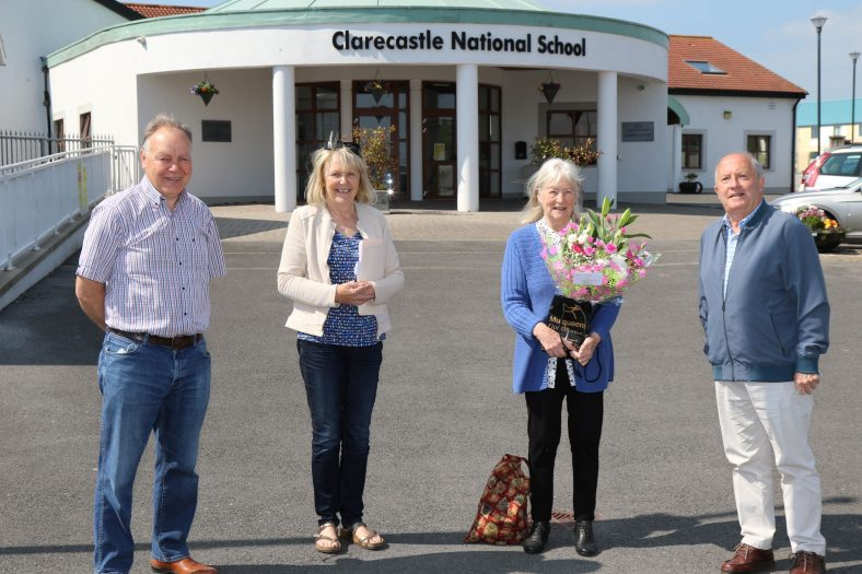 Competition Judge Hilary Gilmore being presented with flowers by Catherine O'Connor, Christy Leyden and Eric Shaw of the Heritage and Wildlife Group. | John Power