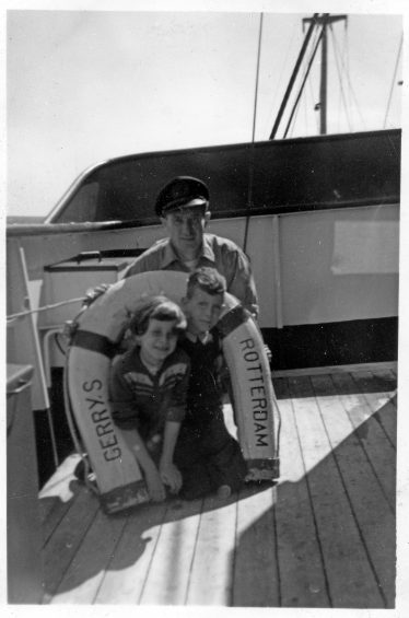 2 Together with my twin sister Lenie and my father on the bridge wing of Gerry-S in the Gulf of Biscay underway to Viano do Castello in July 1956.      | Willem Moojen